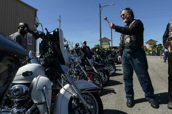 Father Sinclair Oubre throws holy water onto bikes during the 24th Annual B.J. Stelly Bike Blessing at the Port Arthur International Seafarers Center Saturday morning. Photo taken on Saturday, 04/20/19. Ryan Welch/The Enterprise