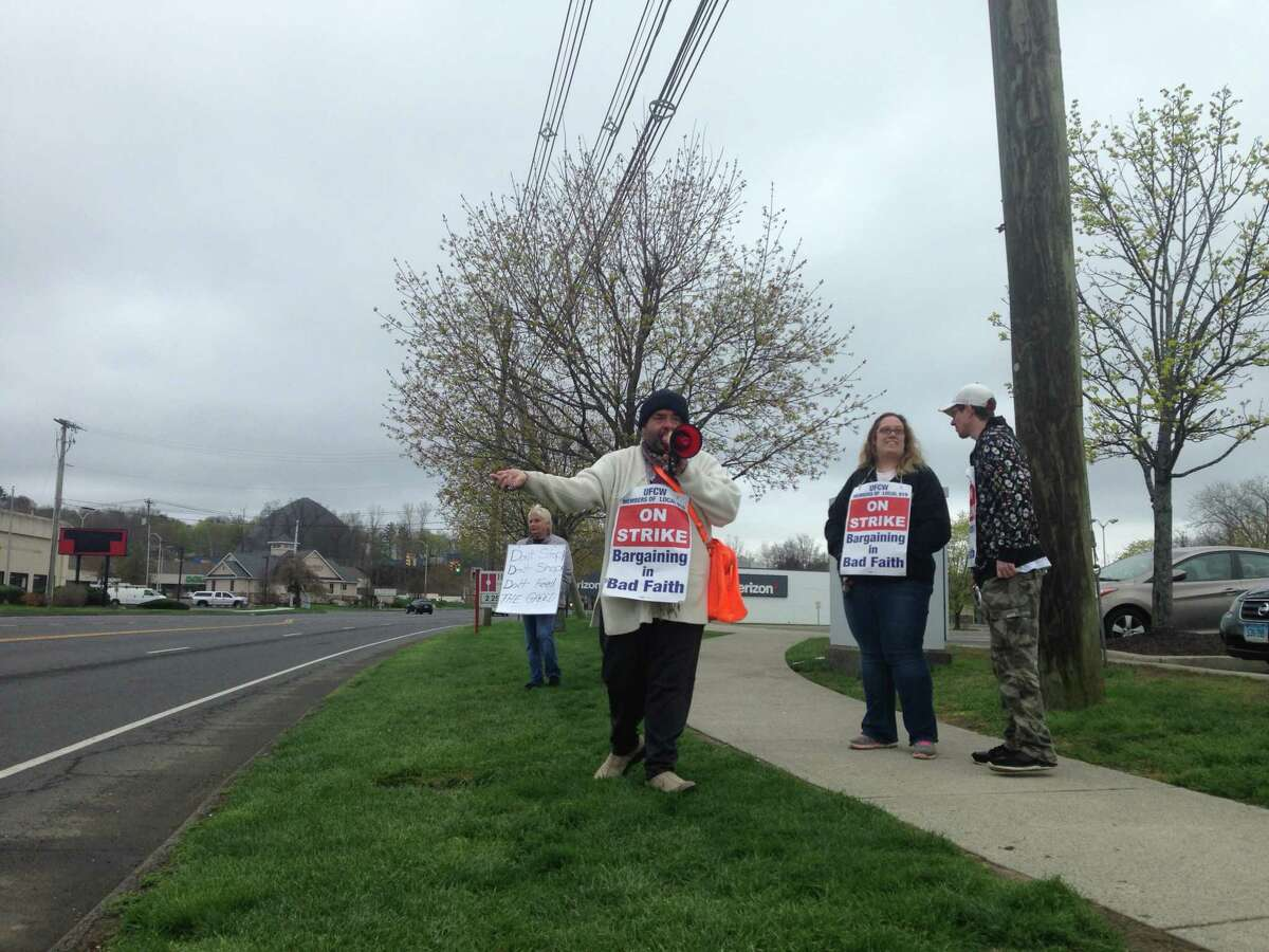 About 15 employees picketed outside the Stop & Shop on Newtown Road in Danbury on the 11th day of the strike against the company. From left to right: Joey Weston, a longtime employee, Christine Ventura, girlfriend of employee supporting strike, and Dave Mach, employee for nine years.