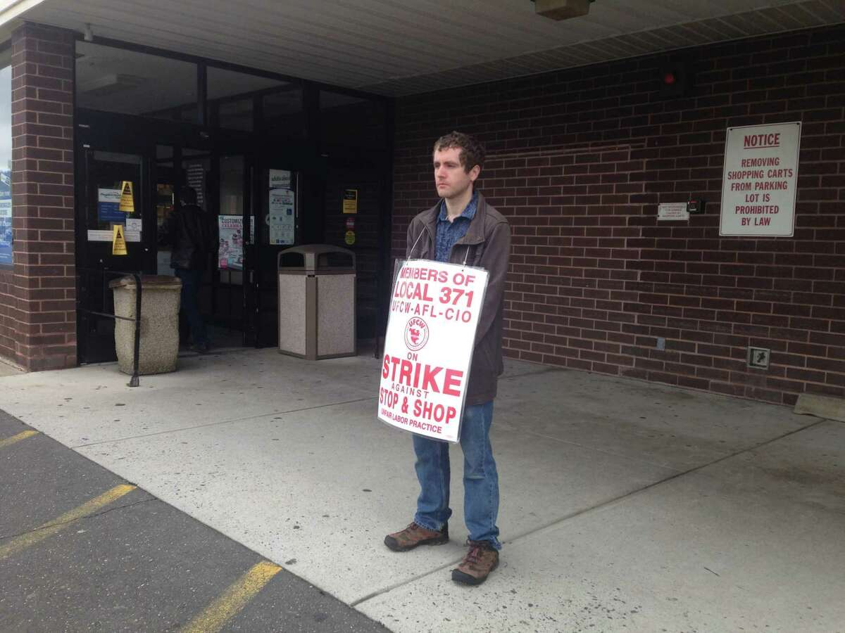 Robert Adams, a part-time worker at Stop & Shop, stands by the door as a customer walks inside the store on Newtown Road in Danbury. Adams was one of about 15 employees picketing outside the store on the 11th day of the strike, which invovles 31,000 workers in Connecticut, Massachusetts and Rhode Island.