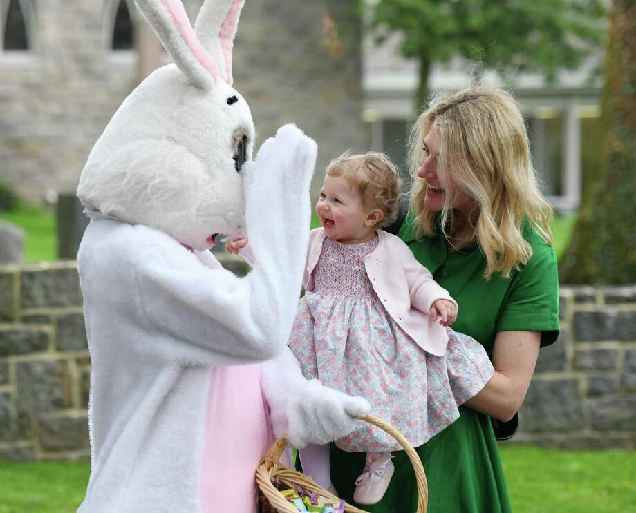 Cos Cob's Sara Yolca and her daughter, Celine Yolac, greet the Easter bunny before the Easter Egg Hunt at Christ Church in Greenwich, Conn. Sunday, April 21, 2019. More than 1,000 congregants attended the two Festival Eucharists in celebration of the resurrection of Jesus. Following the 9 a.m. and 11 a.m. Masses were Easter egg hunts for children held in the memorial garden and cemetery behind the church. Photo: Tyler Sizemore / Hearst Connecticut Media / Greenwich Time
