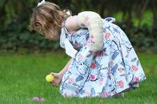 Greenwich's Nora Mazo, 3, finds an egg during the Easter Egg Hunt at Christ Church in Greenwich, Conn. Sunday, April 21, 2019. More than 1,000 congregants attended the two Festival Eucharists in celebration of the resurrection of Jesus. Following the 9 a.m. and 11 a.m. Masses were Easter egg hunts for children held in the memorial garden and cemetery behind the church.