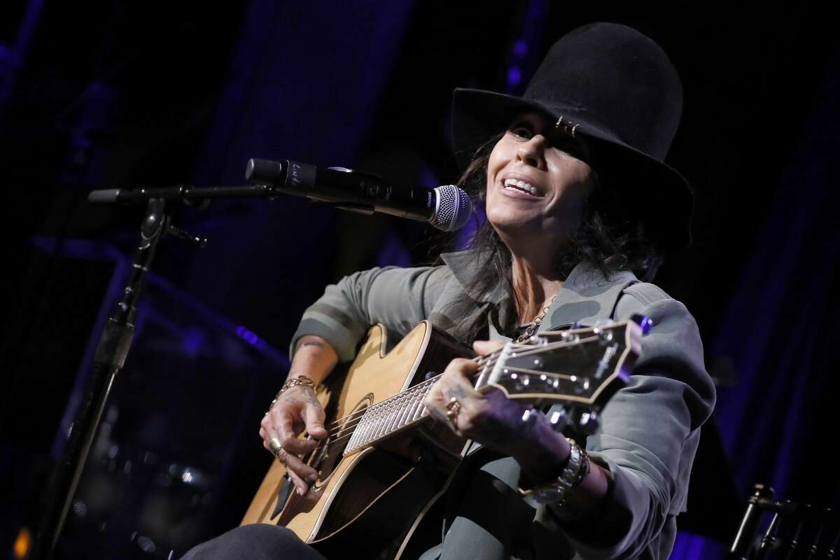 """After feeling that the group had become """"too pop,"""" Linda Perry left 4 Non Blondes in 1995. She started a new band and later became one of the most sought-after songwriters, penning hits for the likes of Christina Aguilera, P!nk, Miley Cyrus and Ariana Grande. She's still performing today, and is seen in this photo at GRAMMYs on the Hill on April 9, 2019 in Washington, DC."""