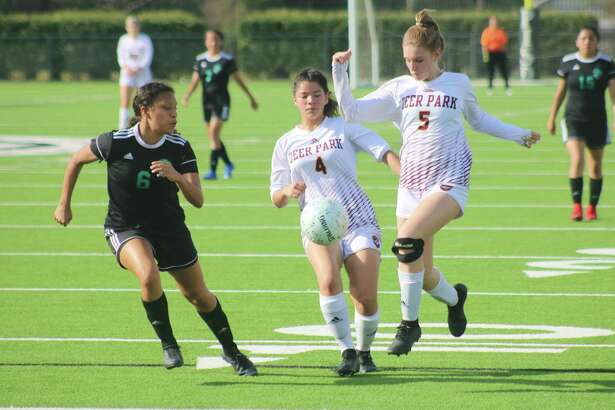 Mariana Alvarez-Garcia (4) and Camden Chance (5), shown in the team's bi-district match with Pasadena Memorial, were presented with all-district accolades for their efforts in helping the team win a new district title.