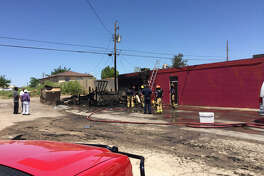 Midland Fire Department works at the scene of a fire Sunday at Sam's Mesquite Cooked Bar-B-Que, Lamesa Road and Scharbauer Drive.