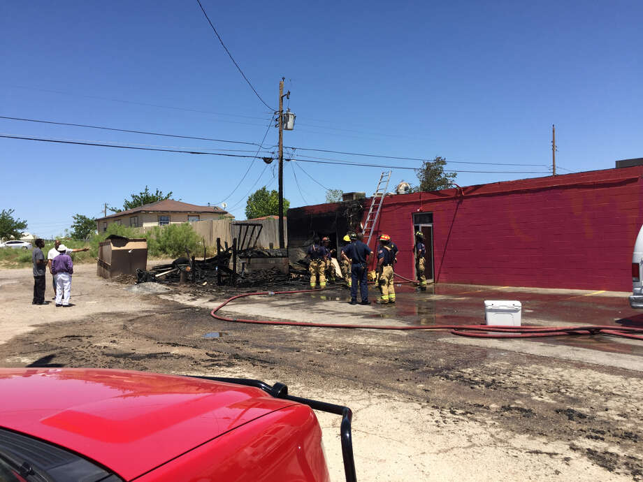Midland Fire Department works at the scene of a fire Sunday at Sam's Mesquite Cooked Bar-B-Que, Lamesa Road and Scharbauer Drive. Photo: Stewart Doreen/Reporter-Telegram