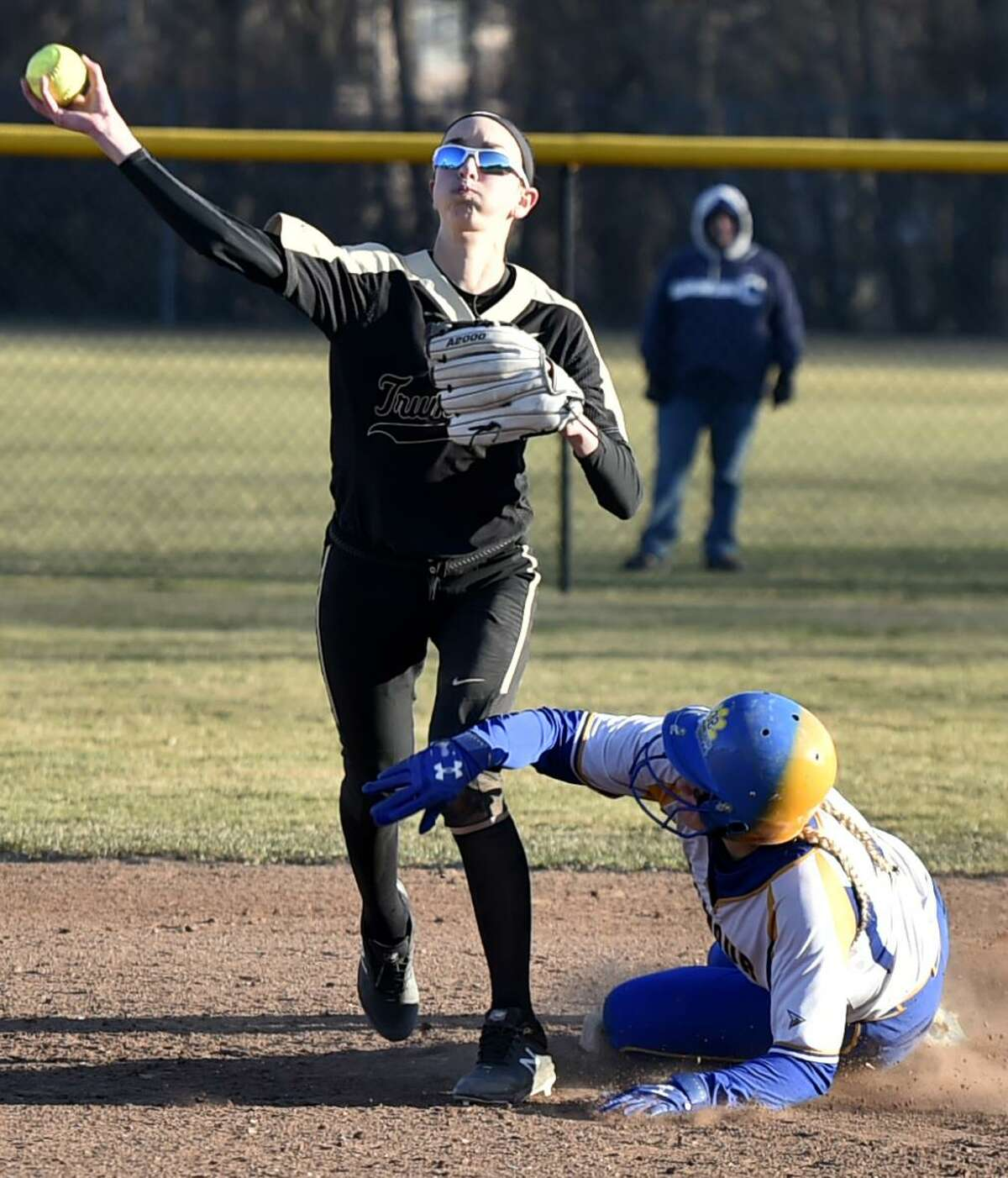 Kenzie Bruggeman, left, and the Trumbull softball team are off to an 8-0 start and are ranked No. 2 in the latest top 10 poll.