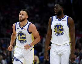 LOS ANGELES, CALIFORNIA - APRIL 21: Stephen Curry #30 of the Golden State Warriors reacts to his second foul with Draymond Green #23 during the first half against the LA Clippers in Game Four of Round One of the 2019 NBA Playoffs at Staples Center on April 21, 2019 in Los Angeles, California. (Photo by Harry How/Getty Images) NOTE TO USER: User expressly acknowledges and agrees that, by downloading and or using this photograph, User is consenting to the terms and conditions of the Getty Images License Agreement.