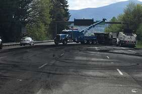 A Semi-truck hauling human waste overturned on eastbound I-90 near Sammamish Sunday after the driver fell asleep, according to the Washington State Department of Transportation.  Three lanes are now open as crews finish cleaning up the area with snowplows. At one point, the backup stretched four miles, WSDOT said.