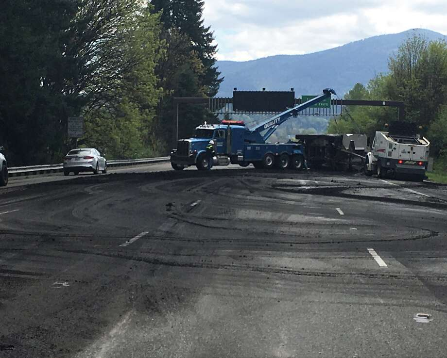 A Semi-truck hauling human waste overturned on eastbound I-90 near Sammamish Sunday after the driver fell asleep, according to the Washington State Department of Transportation.