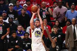 LOS ANGELES, CALIFORNIA - APRIL 21: Klay Thompson #11 of the Golden State Warriors shoots the ball against Lou Williams #23 of the Los Angeles Clippers during the second half of Game Four of Round One of the 2019 NBA Playoffs at Staples Center on April 21, 2019 in Los Angeles, California. NOTE TO USER: User expressly acknowledges and agrees that, by downloading and or using this photograph, User is consenting to the terms and conditions of the Getty Images License Agreement. (Photo by Yong Teck Lim/Getty Images)