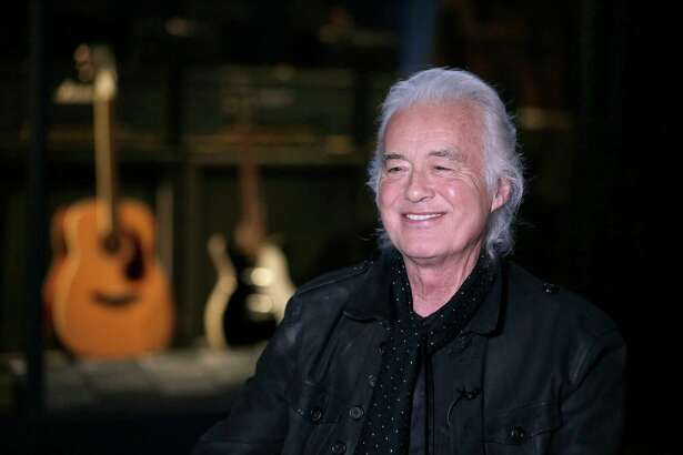 Jimmy Page speaks to a reporter at the Metropolitan Museum of Art in New York, Monday, April 1, 2019. Some of the instruments that Page used to create his Led Zeppelin sound are on display an exhibition called ?Play It Loud: Instruments of Rock & Roll? at the Metropolitan Museum of Art in New York. (AP Photo/Seth Wenig)