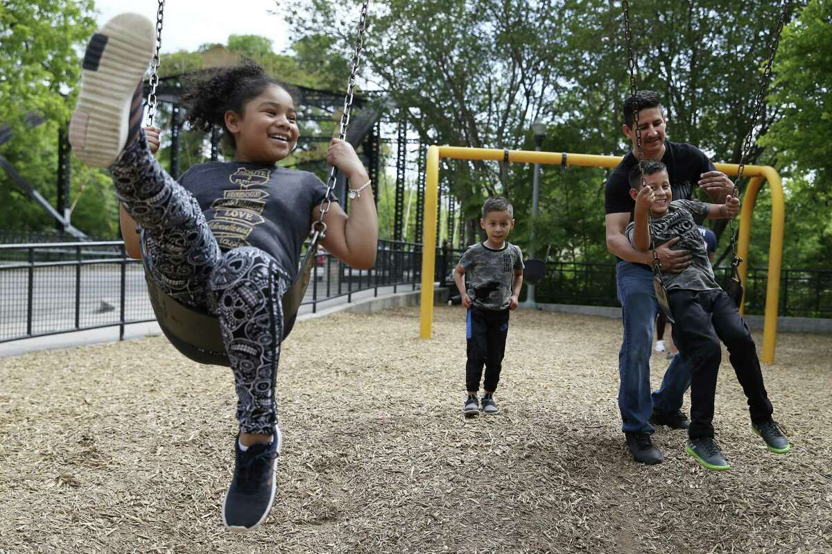 Stella Aguilar, 9, left, joins the Rios family for fun at the swings at Brackenridge Park, Sunday, April 21, 2019. With her are from left, Ivan Rios, 5, Horacio Rios and Diego Rios 10. Thousands gathered at Brackenridge and other city parks in celebration of Easter Sunday.