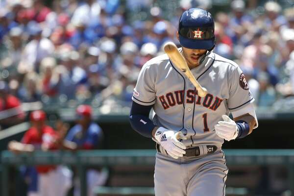 ARLINGTON, TX - APRIL 21: Carlos Correa #1 of the Houston Astros flips his bat after striking out against the Texas Rangers during the first inning at Globe Life Park in Arlington on April 21, 2019 in Arlington, Texas. (Photo by Ron Jenkins/Getty Images)