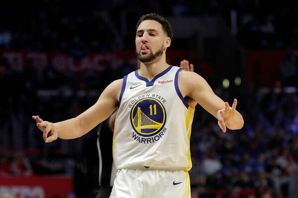 Klay Thompson (11) celebrates his made three pointer in the first half as the Golden State Warriors played the Los Angeles Clippers in Game 4 of the First Round of the NBA Playoffs at Staples Center in Los Angeles, Calif., on Sunday, April 21, 2019.