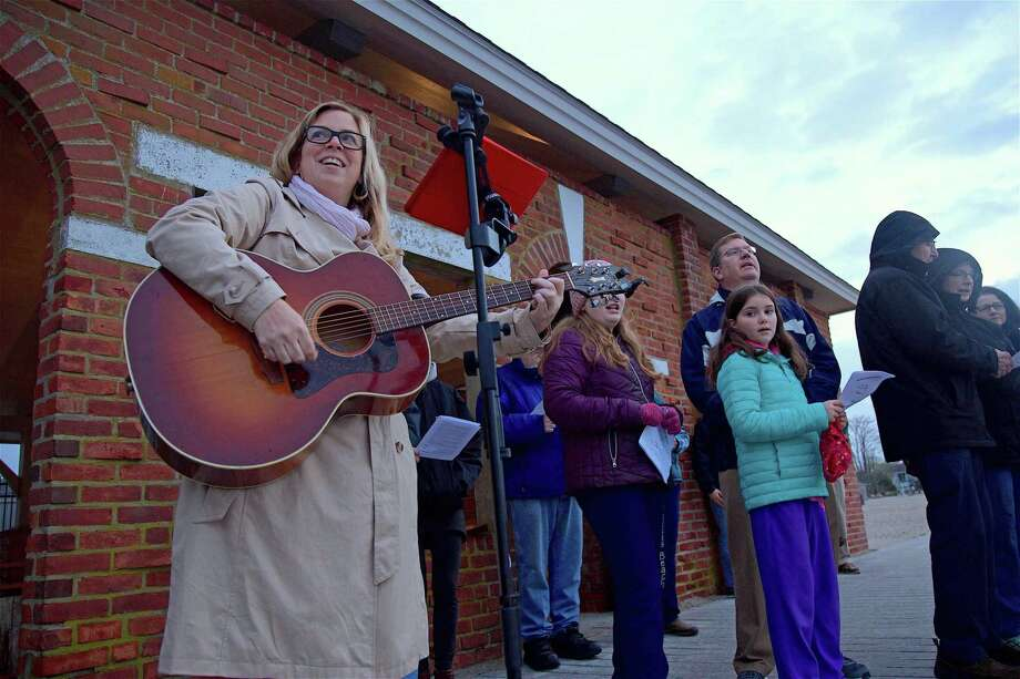 Christina McKay, director of the nursery school at Greens Farms Congregational Church leads a song at the Easter morning Sunrise Service at Compo Beach on Sunday, April 21, 2019, in Westport, Conn. Photo: Jarret Liotta / For Hearst Connecticut Media / Westport News Freelance