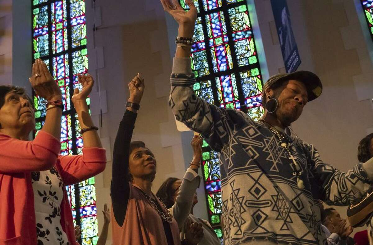 Noni Allwood (left), Arlene Husbands, Kaye Foster and Johnny Be-Goode celebrate Easter with services at Glide Memorial Church, a San Francisco tradition.