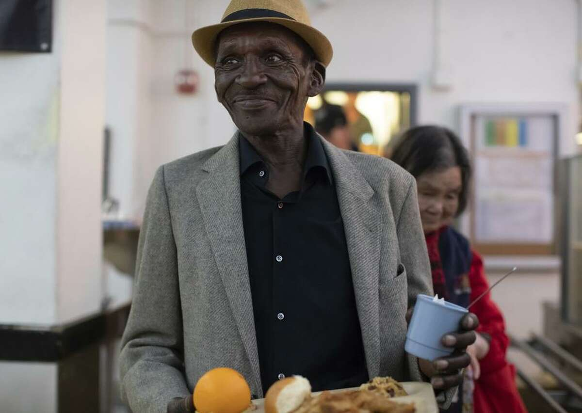 Robert Owen gets his Easter meal in Glide's dining hall.