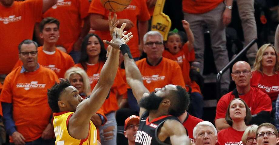 PHOTOS: Rockets-Jazz Game 3 Houston Rockets guard James Harden (13) fouls Utah Jazz guard Donovan Mitchell, left, as he shoots a 3-pointer in the first half during an NBA basketball game Saturday, April 20, 2019, in Salt Lake City. (AP Photo/Rick Bowmer) Browse through the photos to see action from the Rockets' win over the Jazz on Saturday. Photo: Rick Bowmer/Associated Press