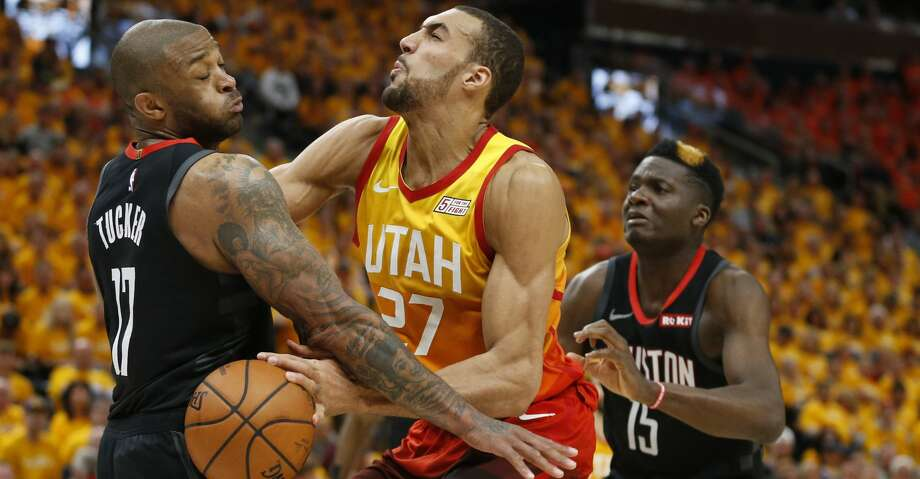 PHOTOS: Rockets-Jazz Game 3 Houston Rockets' PJ Tucker (17) and Clint Capela (15) defend against Utah Jazz center Rudy Gobert (27) in the second half during an NBA basketball game Saturday, April 20, 2019, in Salt Lake City. (AP Photo/Rick Bowmer) Browse through the photos to see action from the Rockets' win over the Jazz in Game 3. Photo: Rick Bowmer/Associated Press