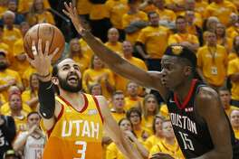 Houston Rockets center Clint Capela (15) defends against Utah Jazz guard Ricky Rubio (3) in the second half during an NBA basketball game Saturday, April 20, 2019, in Salt Lake City. (AP Photo/Rick Bowmer)