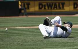 Oakland Athletics pitcher Brett Anderson reacts after being injured on an RBI-single by Toronto Blue Jays' Randal Grichuk during the third inning of a baseball game in Oakland, Calif., Sunday, April 21, 2019. Anderson left the game after the play. (AP Photo/Jeff Chiu)