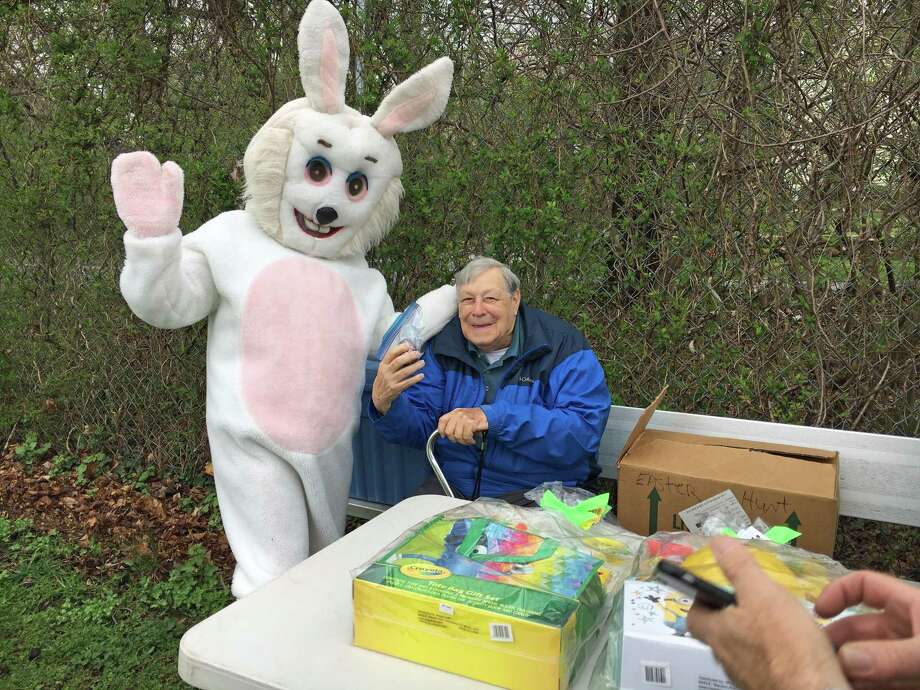 Longtime volunteer Bill Vornkahl poses with the Easter Bunny by the prize table at the Greens Farms Volunteer Fire Company's 68th annual Easter Egg Hunt on April 20, 2019. Photo: Melanie Espinal / For Hearst Connecticut Media