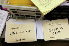 "Files in the ""war room"" set up by Albemarle, Virginia, County Sheriff Chip Harding. He has been trying to reinvestigate the case of Jens Soering, who was convicted of murdering his girlfriend's parents in 1985. Harding, along with author John Grisham, are trying to prove Soering's innocence and get him released from jail."