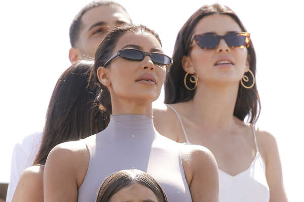 INDIO, CALIFORNIA - APRIL 21: (L-R) Kim Kardashian West, Kendall Jenner and Penelope Scotland Disick attend Sunday Service during the 2019 Coachella Valley Music And Arts Festival on April 21, 2019 in Indio, California. (Photo by Rich Fury/Getty Images for Coachella)