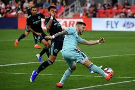D.C. United forward Paul Arriola tries to keep the ball in play despite pressure from New York City FC midfielder Ebenezer Ofori at Audi Field in Washington on Sunday, April 21, 2019. D.C. United lost 2-0 to New York City FC.