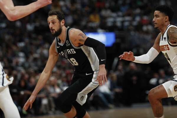 Marco Belinelli, left, being chased by the Nuggets' Gary Harris, has hit 5 of 12 3-pointers, but his attempts per game are down.