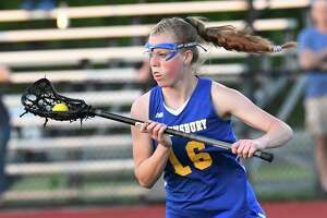 Queensbury's Madeline Montgomery (16)  moves the ball against Niskayuna during a Section II Class B girls' lacrosse final Wednesday, May 23, 2018, in Rotterdam, N.Y. Queensbury won the game 9-8. (Hans Pennink / Special to the Times Union)