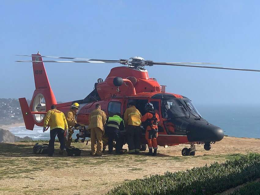 Firefighters work an incident on the Pacifica coast Sunday, April 22, 2019, in which a hang glider died.
