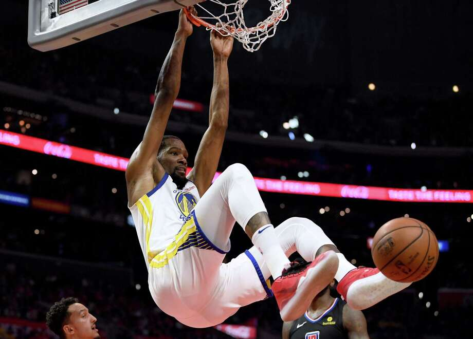 LOS ANGELES, CALIFORNIA - APRIL 21:  Kevin Durant #35 of the Golden State Warriors reacts to his dunk during a 113-105 win over the LA Clippers in Game Four of Round One of the 2019 NBA Playoffs  at Staples Center on April 21, 2019 in Los Angeles, California. (Photo by Harry How/Getty Images)  NOTE TO USER: User expressly acknowledges and agrees that, by downloading and or using this photograph, User is consenting to the terms and conditions of the Getty Images License Agreement. Photo: Harry How / 2019 Getty Images