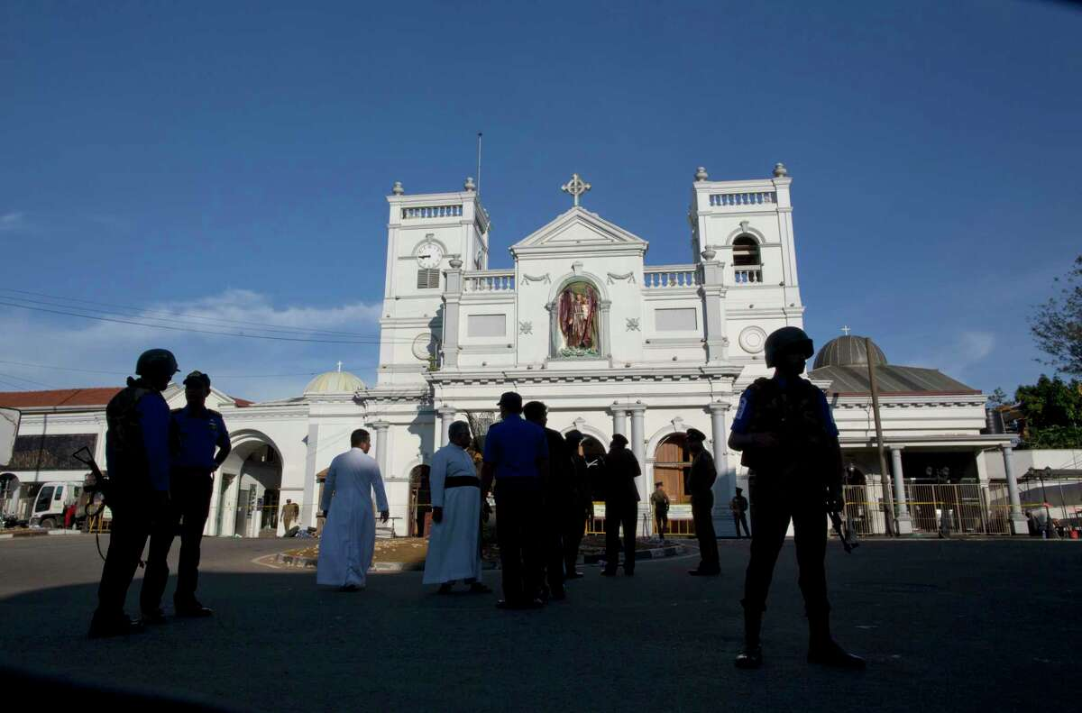 Sri Lankan air force officers and clergy stand outside St. Anthony's Shrine, a day after a blast in Colombo, Sri Lanka, Monday, April 22, 2019. Easter Sunday bombings of churches, luxury hotels and other sites was Sri Lanka's deadliest violence since a devastating civil war in the South Asian island nation ended a decade ago.