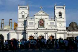 People gather outside St. Anthony's Shrine, a day after a blast in Colombo, Sri Lanka, Monday, April 22, 2019. Easter Sunday bombings of churches, luxury hotels and other sites was Sri Lanka's deadliest violence since a devastating civil war in the South Asian island nation ended a decade ago.