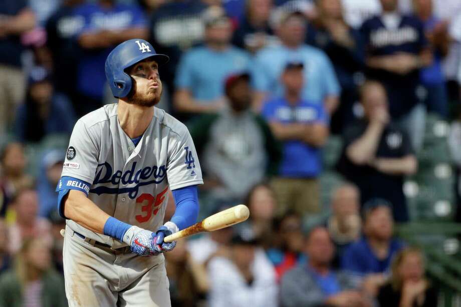 Los Angeles Dodgers' Cody Bellinger watches the ball after hitting a home run during the ninth inning of a baseball game against the Milwaukee Brewers Sunday, April 21, 2019, in Milwaukee. (AP Photo/Aaron Gash) Photo: Aaron Gash / Copyright 2019 The Associated Press. All rights reserved.