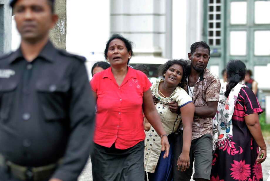 Relatives of a blast victim grieve outside a morgue in Colombo, Sri Lanka, Sunday, April 21, 2019.  More than hundred were killed and hundreds more hospitalized with injuries from eight blasts that rocked churches and hotels in and just outside of Sri Lanka's capital on Easter Sunday, officials said, the worst violence to hit the South Asian country since its civil war ended a decade ago. (AP Photo/Eranga Jayawardena) Photo: Eranga Jayawardena / Copyright 2019 The Associated Press. All rights reserved.