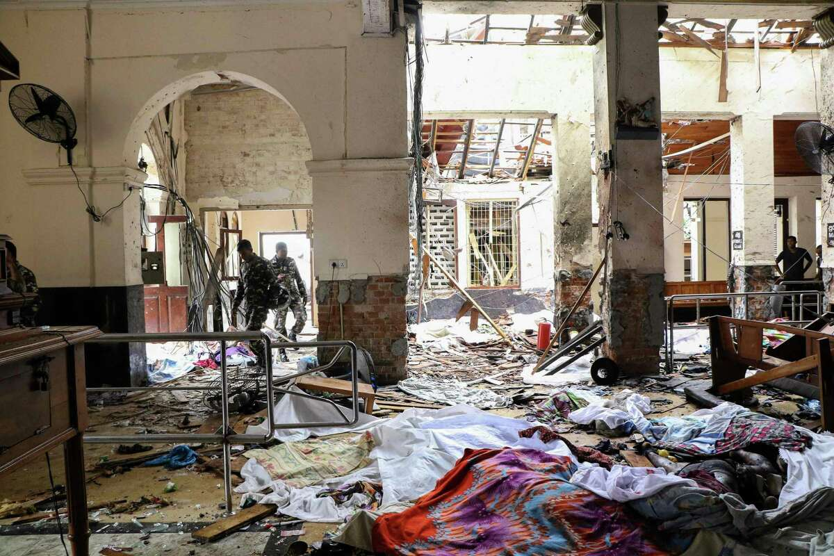 EDITORS NOTE: Graphic content / Sri Lankan security personnel walk next to dead bodies on the floor amid blast debris at St. Anthony's Shrine following an explosion in the church in Kochchikade in Colombo on April 21, 2019. - A string of blasts ripped through high-end hotels and churches holding Easter services in Sri Lanka on April 21, killing at least 156 people, including 35 foreigners. (Photo by ISHARA S. KODIKARA / AFP) / GRAPHIC WARNINGISHARA S. KODIKARA/AFP/Getty Images