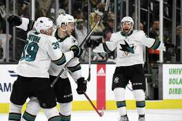 LAS VEGAS, NEVADA - APRIL 21: (L-R) Logan Couture #39, Tomas Hertl #48 and Barclay Goodrow #23 of the San Jose Sharks celebrate after Hertl scored a game-winning short-handed goal at 11:17 of the second overtime period of Game Six of the Western Conference First Round during the 2019 NHL Stanley Cup Playoffs at T-Mobile Arena on April 21, 2019 in Las Vegas, Nevada. The series is now even at 3-3. (Photo by Ethan Miller/Getty Images)