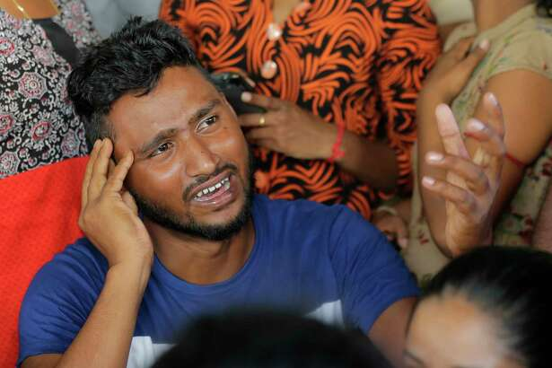 A Sri Lankan man cries while looking for the bodies of his family members killed in yesterday church blasts in a mortuary in Colombo, Sri Lanka, Monday, April 22, 2019. Easter Sunday bombings of churches, luxury hotels and other sites that killed hundreds of people was Sri Lanka's deadliest violence since a devastating civil war in the South Asian island nation ended a decade ago.