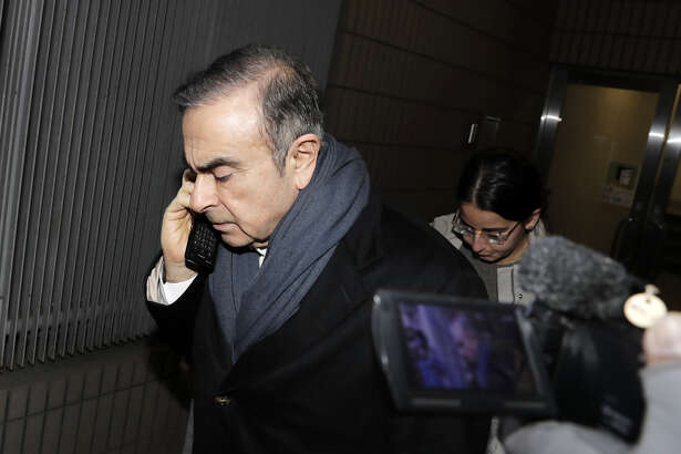 Carlos Ghosn, former chairman of Nissan Motor Co., leaves the office of his lawyer Junichiro Hironaka in Tokyo on March 12, 2019.