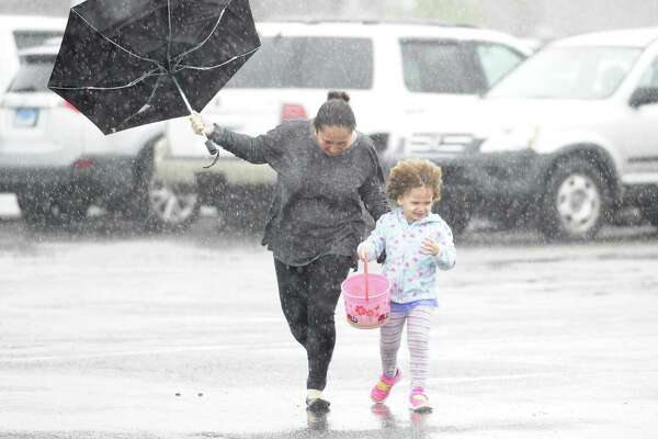 Martha Rivera of Norwalk, braves the weather with her daughter Sofia as they arrive to a community Easter egg hunt at Calf Pasture Beach on Saturday, April 20, 2019 in Norwalk. The event was hosted by the Word Alive Bible Church of Norwalk and featured over 10,000 eggs filled with surprises.