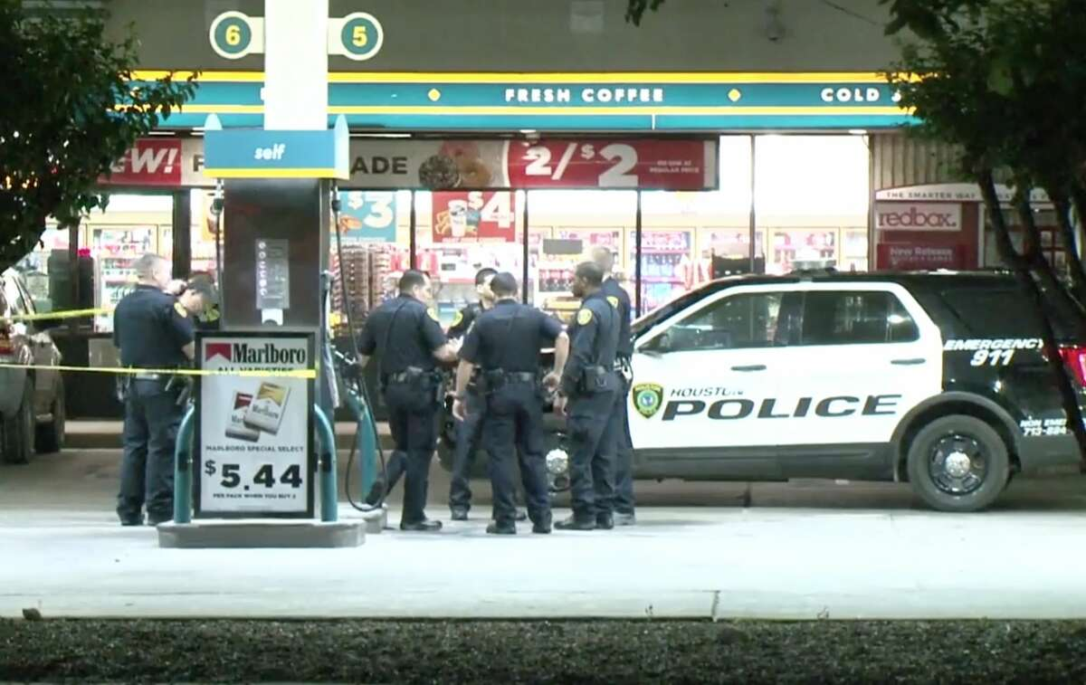 Houston police officers investigate a scene where an off-duty Harris County Precinct 6 Constable's Office deputy shot a suspected robber at a Valero gas station near Gessner and Clay on Sunday, April 21, 2019.