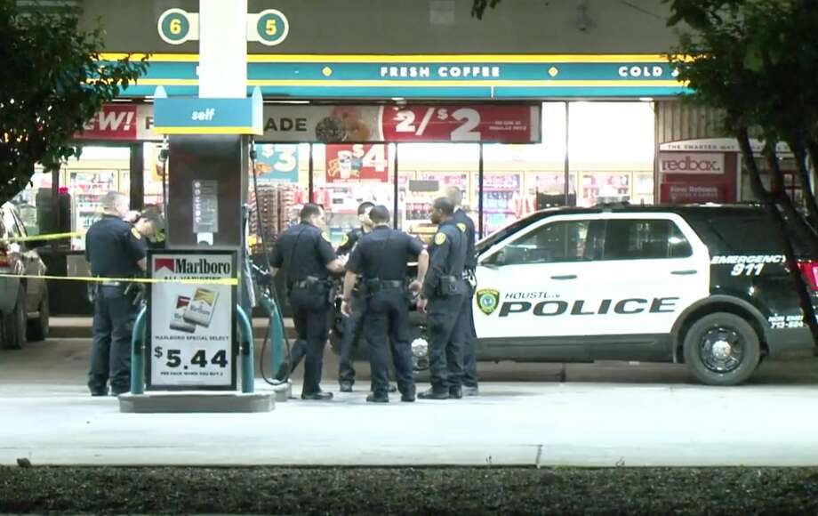 Houston police officers investigate a scene where an off-duty Harris County Precinct 6 Constable's Office deputy shot a suspected robber at a Valero gas station near Gessner and Clay on Sunday, April 21, 2019. Photo: Metro Video