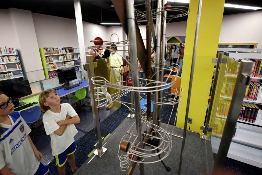 Youngsters explore the children's section following a dedication ceremony April 4 at the newly renovated Midland County Public Library downtown branch. Photo: James Durbin/Reporter-Telegram / © 2019 All Rights Reserved