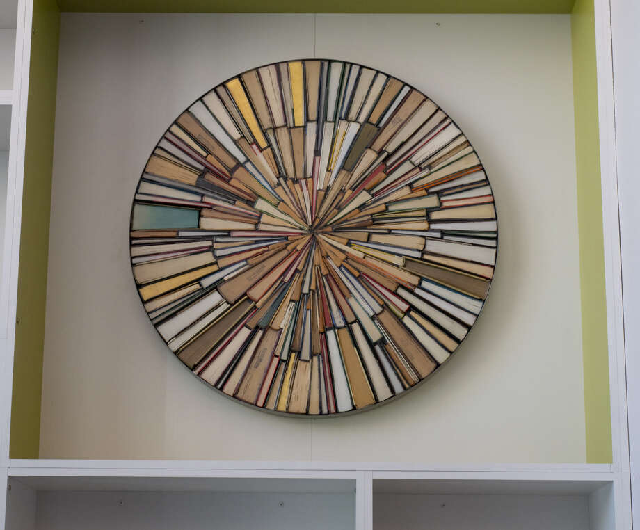 Lubbock artist Jonathan Whitfill used old books to create a piece of art for the renovated Midland County Public Library downtown branch. Photo: Tim Fischer/Reporter-Telegram