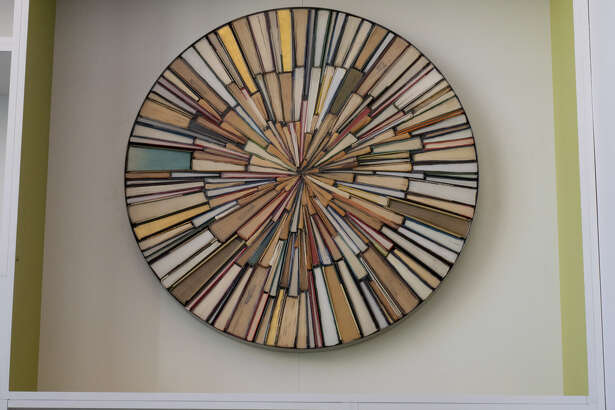 Lubbock artist Jonathan Whitfill used old books to create a piece of art for the renovated Midland County Public Library downtown branch.