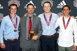 SIUE's (from left) Brooks Jungbluth, coach Derrick Brown, Kyle Slattery and Conor Dore were honored for their season over the weekend at the OVC Tournament in Muscle Shoals, Ala.