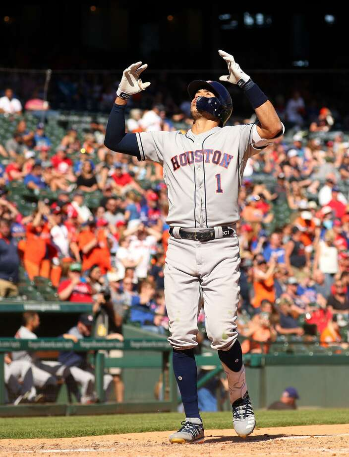 Houston Astros' Carlos Correa (1) gestures as he crosses the plate after a solo home run in the eighth inning against the Texas Rangers on Sunday, April 21, 2019 in Arlington, Texas. (Richard W. Rodriguez/Fort Worth Star-Telegram/TNS) Photo: Richard W. Rodriguez, MBR / TNS / Fort Worth Star-Telegram