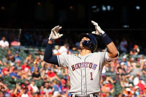 Houston Astros' Carlos Correa (1) gestures as he crosses the plate after a solo home run in the eighth inning against the Texas Rangers on Sunday, April 21, 2019 in Arlington, Texas. (Richard W. Rodriguez/Fort Worth Star-Telegram/TNS)
